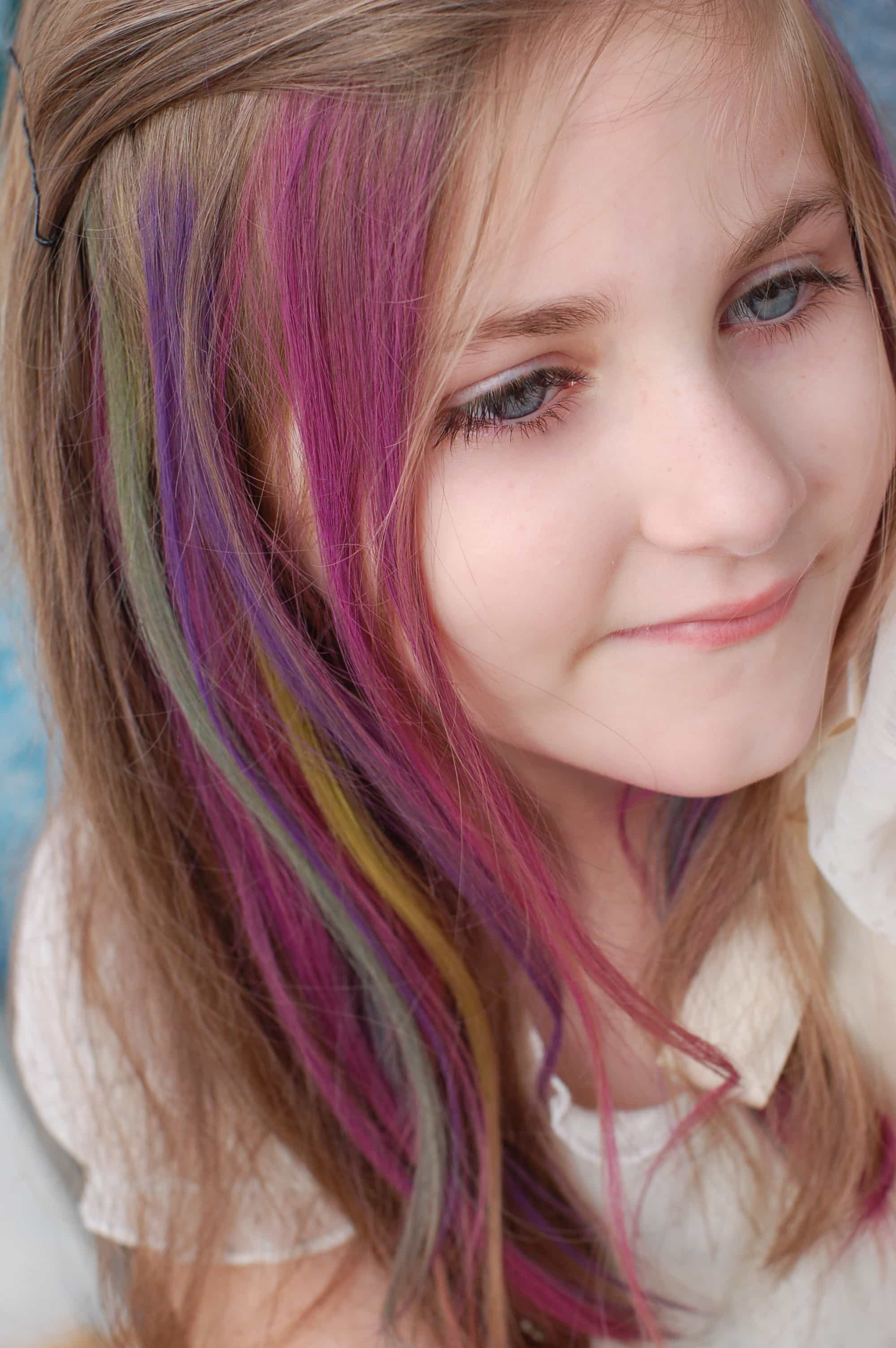 This little girl is rocking temporary hair color. Do you know what all the different types of hair color are? Find out now..